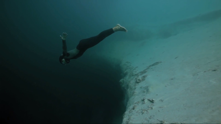 Guillaume Nery base jumping at Dean's Blue Hole